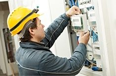 man working on electrical systems